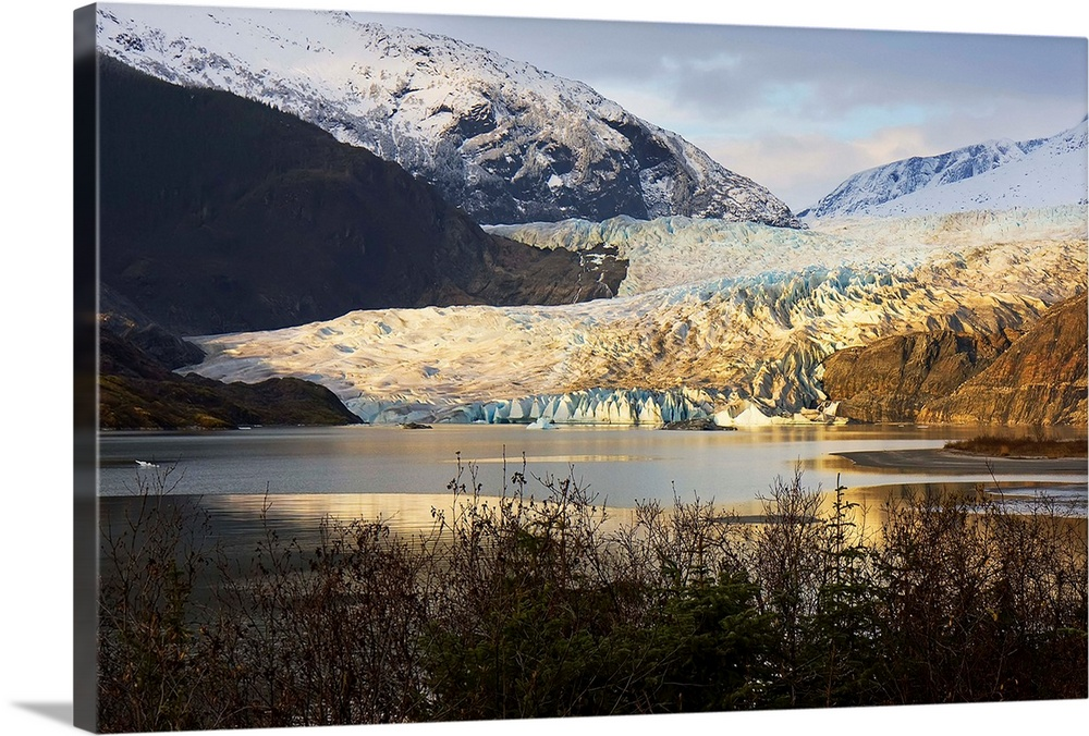 Large Solid-Faced Canvas Print Wall Art Print 30 x 20 entitled Scenic view of Mendenhall Glacier near Juneau, Alaska in la... Solid-Faced Canvas Print entitled Scenic view of Mendenhall Glacier near Juneau, Alaska in late Autumn.  Multiple sizes available.  Primary colors within this image include Brown, Black, Gray, White.  Made in USA.  Satisfaction guaranteed.  Archival-quality UV-resistant inks.  Archival inks prevent fading and preserve as much fine detail as possible with no over-saturation or color shifting.  Canvas is handcrafted and made-to-order in the United States using high quality artist-grade canvas.