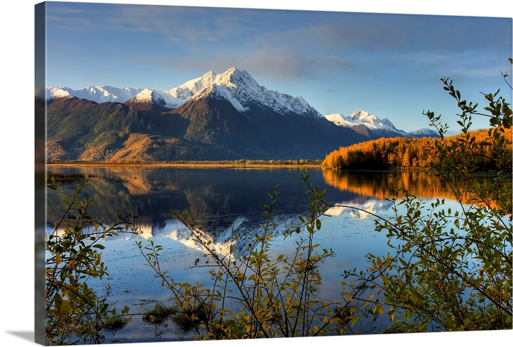 Large Solid-Faced Canvas Print Wall Art Print 30 x 20 entitled Scenic view of Pioneer Peak reflecting in Jim Lake in Mat S... Solid-Faced Canvas Print entitled Scenic view of Pioneer Peak reflecting in Jim Lake in Mat Su Valley, Alaska.  Multiple sizes available.  Primary colors within this image include Brown, Peach, Black, Dark Forest Green.  Made in USA.  All products come with a 365 day workmanship guarantee.  Inks used are latex-based and designed to last.  Archival inks prevent fading and preserve as much fine detail as possible with no over-saturation or color shifting.  Featuring a proprietary design, our canvases produce the tightest corners without any bubbles, ripples, or bumps and will not warp or sag over time.
