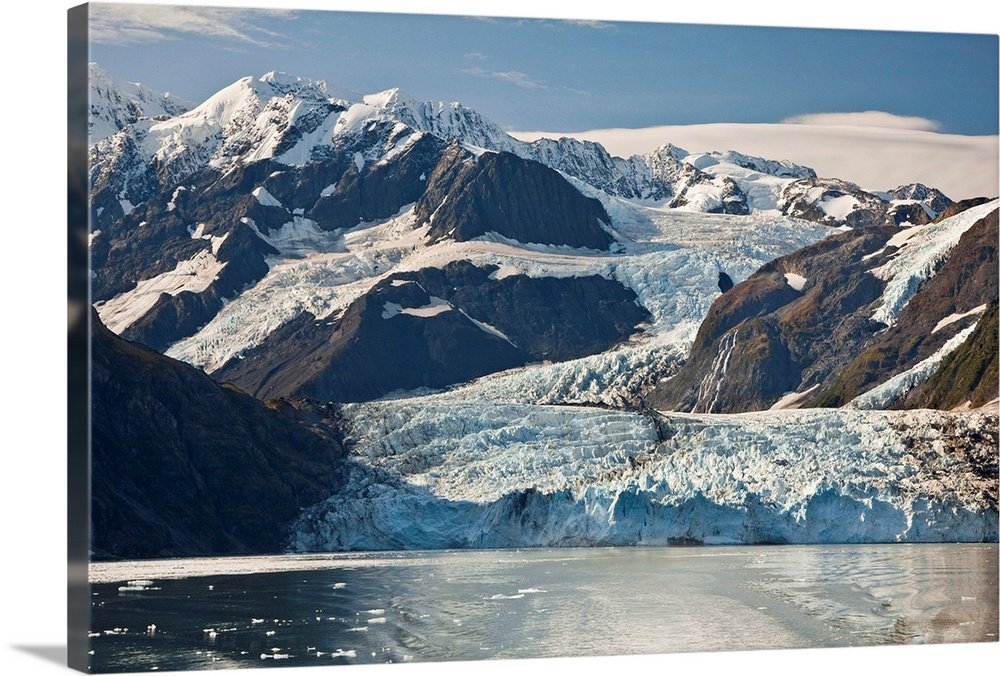 Large Solid-Faced Canvas Print Wall Art Print 30 x 20 entitled Scenic view of Stairway glacier flowing into Surprise Glacier Solid-Faced Canvas Print entitled Scenic view of Stairway glacier flowing into Surprise Glacier.  Multiple sizes available.  Primary colors within this image include White, Dark Navy Blue, Light Gray Blue.  Made in the USA.  Satisfaction guaranteed.  Archival-quality UV-resistant inks.  Featuring a proprietary design, our canvases produce the tightest corners without any bubbles, ripples, or bumps and will not warp or sag over time.  Canvas depth is 1.25 and includes a finished backing with pre-installed hanging hardware.