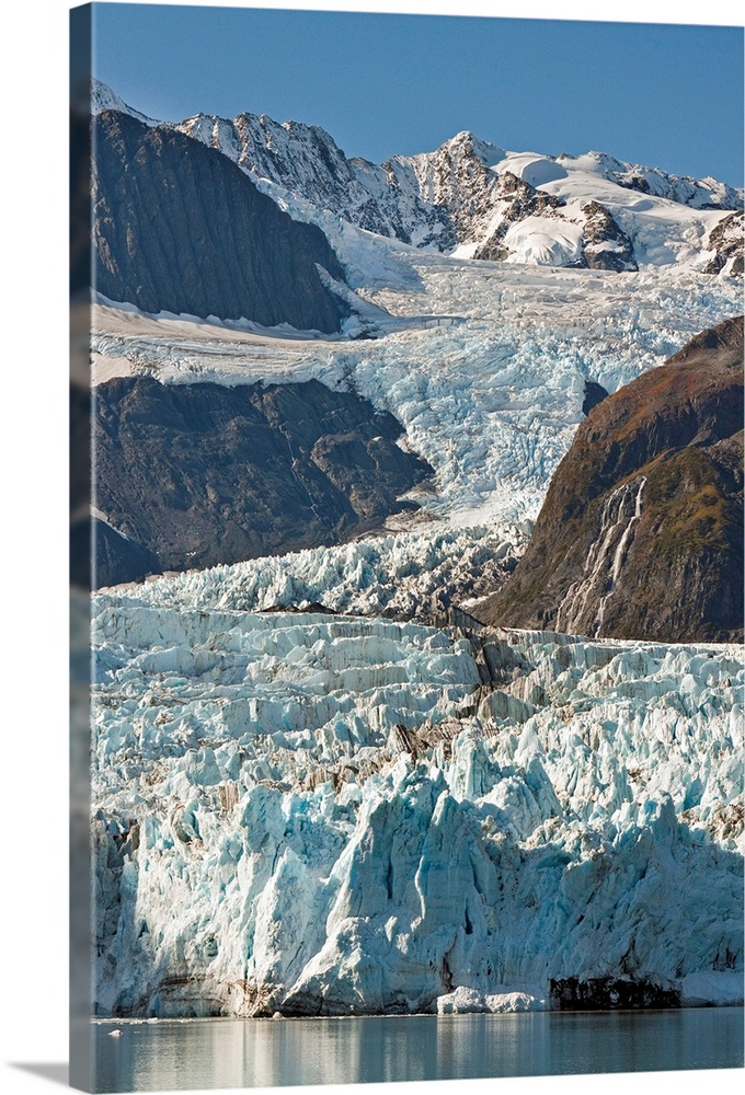 Large Solid-Faced Canvas Print Wall Art Print 20 x 30 entitled Scenic view of Stairway glacier flowing into Surprise Glaci... Solid-Faced Canvas Print entitled Scenic view of Stairway glacier flowing into Surprise Glacier from Chugach Mountains.  Multiple sizes available.  Primary colors within this image include Black, White, Gray Blue.  Made in the USA.  Satisfaction guaranteed.  Archival-quality UV-resistant inks.  Canvas is handcrafted and made-to-order in the United States using high quality artist-grade canvas.  Canvas depth is 1.25 and includes a finished backing with pre-installed hanging hardware.