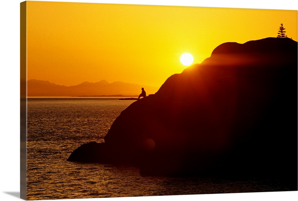Large Solid-Faced Canvas Print Wall Art Print 30 x 20 entitled Silhouette of Person on Rock Turnagain Arm SC AK Solid-Faced Canvas Print entitled Silhouette of Person on Rock Turnagain Arm SC AK.  Multiple sizes available.  Primary colors within this image include Orange, Dark Red, Black, White.  Made in the USA.  All products come with a 365 day workmanship guarantee.  Inks used are latex-based and designed to last.  Featuring a proprietary design, our canvases produce the tightest corners without any bubbles, ripples, or bumps and will not warp or sag over time.  Canvas depth is 1.25 and includes a finished backing with pre-installed hanging hardware.