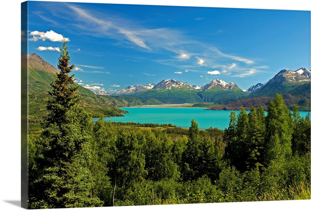 Large Solid-Faced Canvas Print Wall Art Print 30 x 20 entitled Skilak Lake in the Kenai National Wildlife Refuge with the ... Solid-Faced Canvas Print entitled Skilak Lake in the Kenai National Wildlife Refuge with the Kenai Mountains in distance.  Large canvas photo art of a forest surrounding a clear lake with snowcapped mountains in the distance.  Multiple sizes available.  Primary colors within this image include Forest Green, Black, Royal Blue, Teal.  Made in the USA.  All products come with a 365 day workmanship guarantee.  Inks used are latex-based and designed to last.  Canvas depth is 1.25 and includes a finished backing with pre-installed hanging hardware.  Archival inks prevent fading and preserve as much fine detail as possible with no over-saturation or color shifting.