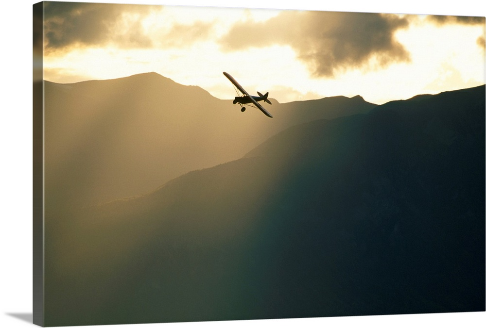 Large Solid-Faced Canvas Print Wall Art Print 30 x 20 entitled Small Plane Flightseeing Wrangell St Elias Mountains, Pilot... Solid-Faced Canvas Print entitled Small Plane Flightseeing Wrangell St Elias Mountains, Piloted by Paul Claus.  Multiple sizes available.  Primary colors within this image include Peach, Black, White.  Made in USA.  Satisfaction guaranteed.  Inks used are latex-based and designed to last.  Canvas is handcrafted and made-to-order in the United States using high quality artist-grade canvas.  Canvas depth is 1.25 and includes a finished backing with pre-installed hanging hardware.