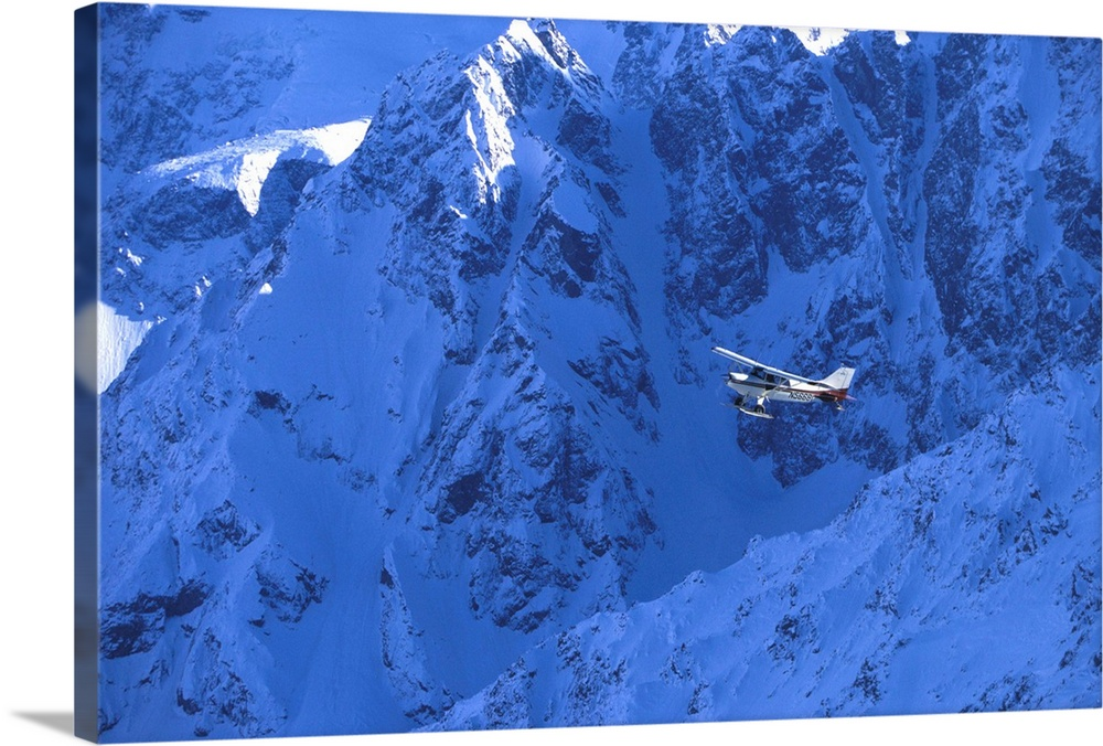 Large Solid-Faced Canvas Print Wall Art Print 30 x 20 entitled Small Plane Flying Above Chugach Mountains, Southcentral Al... Solid-Faced Canvas Print entitled Small Plane Flying Above Chugach Mountains, Southcentral Alaska.  Multiple sizes available.  Primary colors within this image include White, Royal Blue, Dark Navy Blue.  Made in USA.  All products come with a 365 day workmanship guarantee.  Archival-quality UV-resistant inks.  Canvas is handcrafted and made-to-order in the United States using high quality artist-grade canvas.  Archival inks prevent fading and preserve as much fine detail as possible with no over-saturation or color shifting.