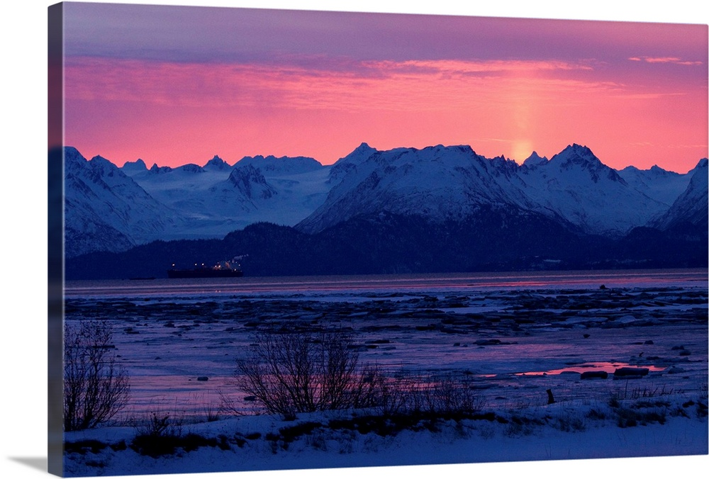 Large Solid-Faced Canvas Print Wall Art Print 30 x 20 entitled Sun sets over rugged mountain landscape Solid-Faced Canvas Print entitled Sun sets over rugged mountain landscape.  Multiple sizes available.  Primary colors within this image include Dark Blue, Pink, Black, Gray Blue.  Made in USA.  All products come with a 365 day workmanship guarantee.  Archival-quality UV-resistant inks.  Featuring a proprietary design, our canvases produce the tightest corners without any bubbles, ripples, or bumps and will not warp or sag over time.  Canvas is handcrafted and made-to-order in the United States using high quality artist-grade canvas.