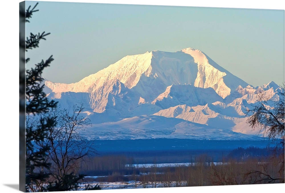 Large Solid-Faced Canvas Print Wall Art Print 30 x 20 entitled Sunrise on Mt. Foraker as seen near Talkeetna, Alaska Solid-Faced Canvas Print entitled Sunrise on Mt. Foraker as seen near Talkeetna, Alaska.  Multiple sizes available.  Primary colors within this image include Peach, Black, Gray, Muted Blue.  Made in USA.  Satisfaction guaranteed.  Archival-quality UV-resistant inks.  Archival inks prevent fading and preserve as much fine detail as possible with no over-saturation or color shifting.  Featuring a proprietary design, our canvases produce the tightest corners without any bubbles, ripples, or bumps and will not warp or sag over time.