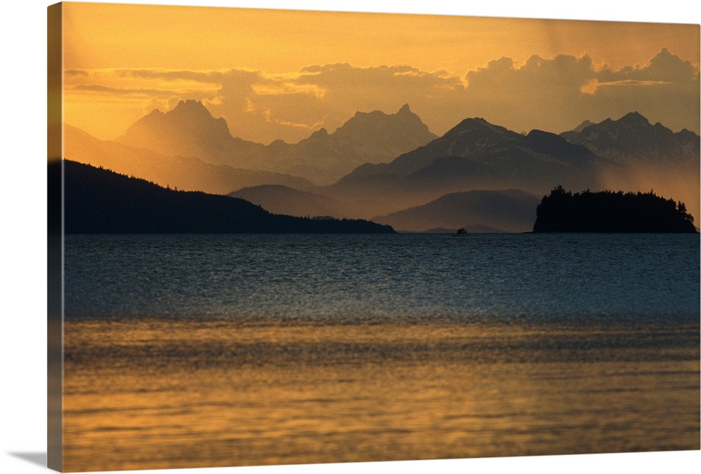 Large Solid-Faced Canvas Print Wall Art Print 30 x 20 entitled Sunset at Chilkat Range and Favorite Channel SE Alaska Summer Solid-Faced Canvas Print entitled Sunset at Chilkat Range and Favorite Channel SE Alaska Summer.  Multiple sizes available.  Primary colors within this image include Brown, Peach, Dark Gray.  Made in the USA.  All products come with a 365 day workmanship guarantee.  Inks used are latex-based and designed to last.  Archival inks prevent fading and preserve as much fine detail as possible with no over-saturation or color shifting.  Canvas is handcrafted and made-to-order in the United States using high quality artist-grade canvas.