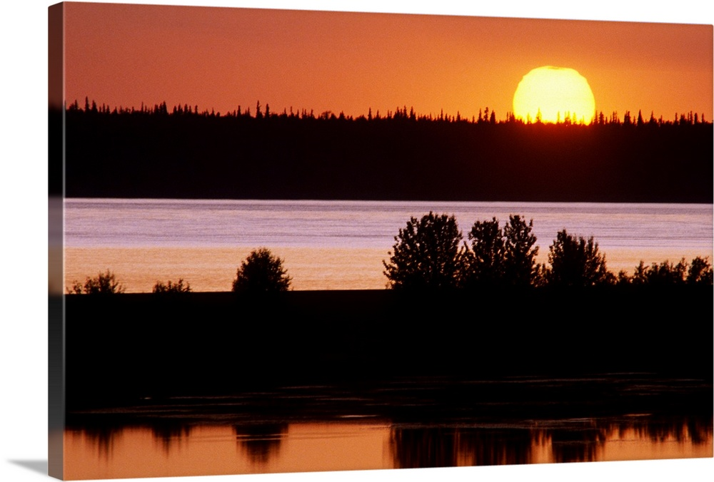 Large Solid-Faced Canvas Print Wall Art Print 30 x 20 entitled Sunset over Cook Inlet Southcentral Alaska Summer Solid-Faced Canvas Print entitled Sunset over Cook Inlet Southcentral Alaska Summer.  Multiple sizes available.  Primary colors within this image include Orange, Dark Red, Light Yellow, Black.  Made in USA.  Satisfaction guaranteed.  Inks used are latex-based and designed to last.  Canvas depth is 1.25 and includes a finished backing with pre-installed hanging hardware.  Archival inks prevent fading and preserve as much fine detail as possible with no over-saturation or color shifting.