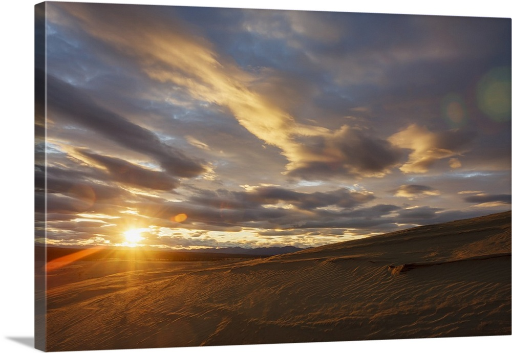 Large Solid-Faced Canvas Print Wall Art Print 30 x 20 entitled The Great Kobuk Sand Dunes With The Shadows Of The Arctic M... Solid-Faced Canvas Print entitled The Great Kobuk Sand Dunes With The Shadows Of The Arctic Midnight Sunset.  The Great Kobuk Sand Dunes With The Shadows Of The Arctic Midnight Sunset, Kobuk Valley National Park, Northwest Alaska, Arctic, Summer.  Multiple sizes available.  Primary colors within this image include Brown, Peach, Dark Gray, Gray Blue.  Made in USA.  Satisfaction guaranteed.  Inks used are latex-based and designed to last.  Canvas depth is 1.25 and includes a finished backing with pre-installed hanging hardware.  Archival inks prevent fading and preserve as much fine detail as possible with no over-saturation or color shifting.