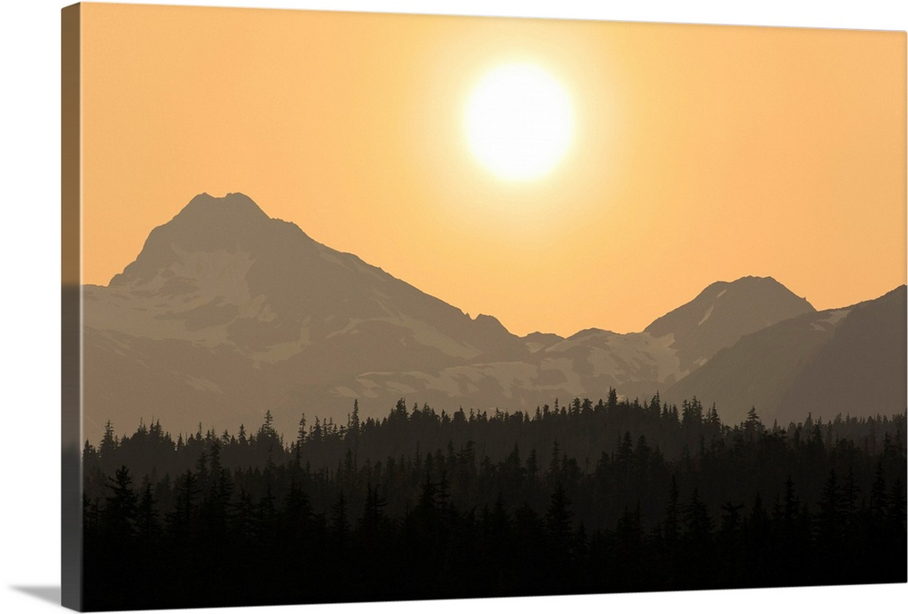 Large Solid-Faced Canvas Print Wall Art Print 30 x 20 entitled The sun sets over the Chilkat Mountains, Tongass Forest, Al... Solid-Faced Canvas Print entitled The sun sets over the Chilkat Mountains, Tongass Forest, Alaska.  Multiple sizes available.  Primary colors within this image include Peach, Black, Gray, White.  Made in USA.  Satisfaction guaranteed.  Inks used are latex-based and designed to last.  Canvas depth is 1.25 and includes a finished backing with pre-installed hanging hardware.  Canvas is handcrafted and made-to-order in the United States using high quality artist-grade canvas.