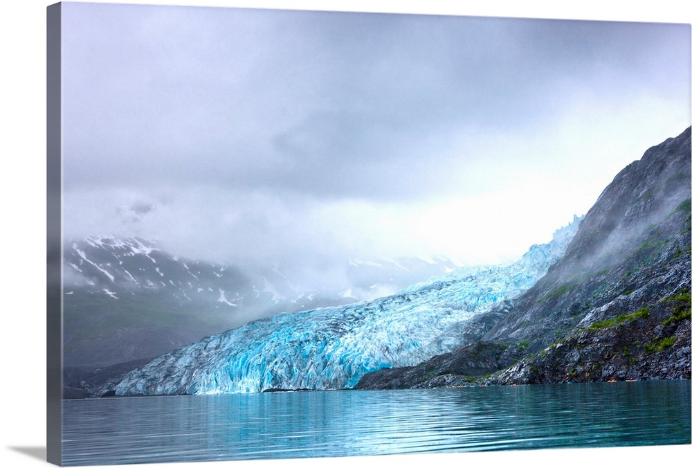 Large Solid-Faced Canvas Print Wall Art Print 30 x 20 entitled View of Shoup Glacier through fog, Shoup Bay State Marine P... Solid-Faced Canvas Print entitled View of Shoup Glacier through fog, Shoup Bay State Marine Park, Prince William Sound,.  Multiple sizes available.  Primary colors within this image include Black, White, Gray Blue.  Made in USA.  All products come with a 365 day workmanship guarantee.  Archival-quality UV-resistant inks.  Archival inks prevent fading and preserve as much fine detail as possible with no over-saturation or color shifting.  Featuring a proprietary design, our canvases produce the tightest corners without any bubbles, ripples, or bumps and will not warp or sag over time.