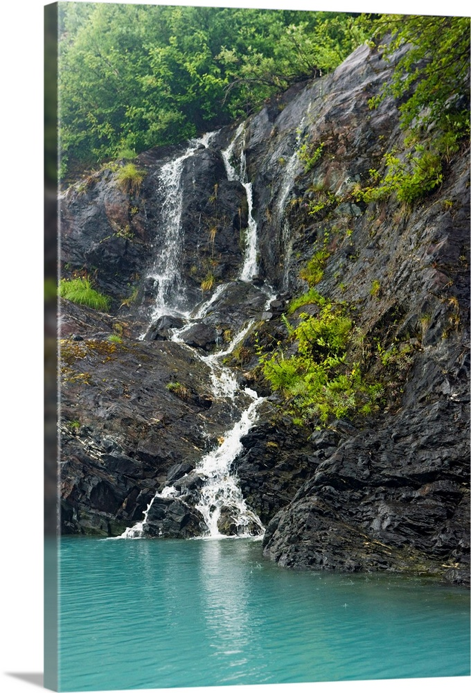 Large Solid-Faced Canvas Print Wall Art Print 20 x 30 entitled View of waterfalls in Passage Canal, Whittier, Southcentral... Solid-Faced Canvas Print entitled View of waterfalls in Passage Canal, Whittier, Southcentral Alaska, Summer.  Multiple sizes available.  Primary colors within this image include Dark Yellow, Black, White, Teal.  Made in USA.  All products come with a 365 day workmanship guarantee.  Archival-quality UV-resistant inks.  Archival inks prevent fading and preserve as much fine detail as possible with no over-saturation or color shifting.  Canvas is handcrafted and made-to-order in the United States using high quality artist-grade canvas.