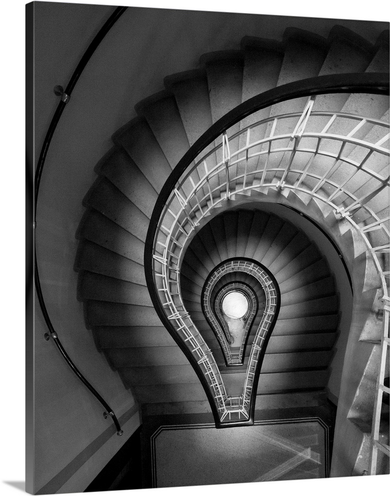 Large Gallery-Wrapped Canvas Wall Art Print 16 x 20 entitled I Have An Idea Gallery-Wrapped Canvas entitled I Have An Idea.  black and white photograph stairs spiral staircase lightbulb.  Multiple sizes available.  Primary colors within this image include Dark Gray Silver.  Made in the USA.  All products come with a 365 day workmanship guarantee.  Archival-quality UV-resistant inks.  Canvas is acid-free and 20 millimeters thick.  Canvas is designed to prevent fading.