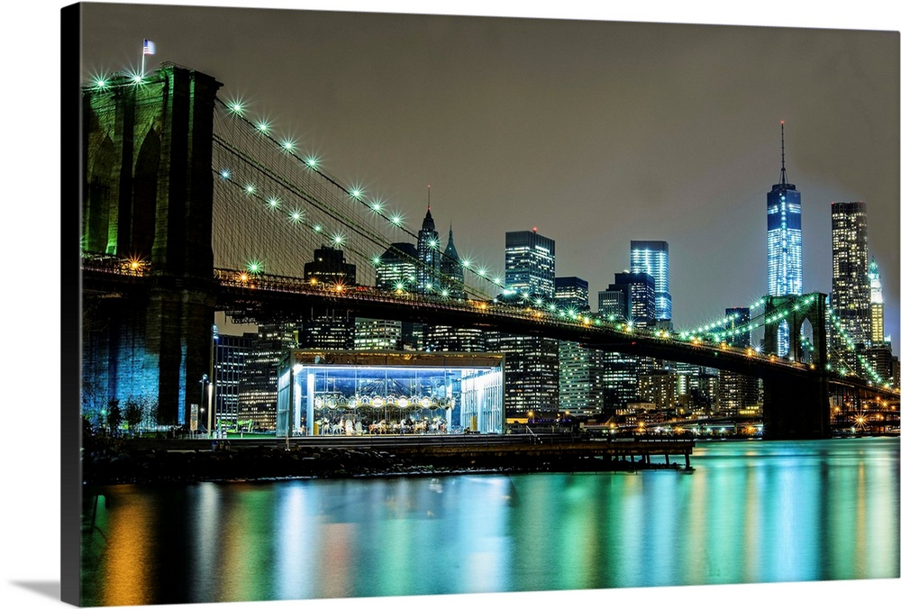 Large Solid-Faced Canvas Print Wall Art Print 36 x 24 entitled Brooklyn Bridge, Jane's Carousel And Freedom Tower Solid-Faced Canvas Print entitled Brooklyn Bridge, Janes Carousel And Freedom Tower.  Multiple sizes available.  Primary colors within this image include Brown, Black, White, Muted Blue.  Made in the USA.  Satisfaction guaranteed.  Inks used are latex-based and designed to last.  Featuring a proprietary design, our canvases produce the tightest corners without any bubbles, ripples, or bumps and will not warp or sag over time.  Canvas is handcrafted and made-to-order in the United States using high quality artist-grade canvas.