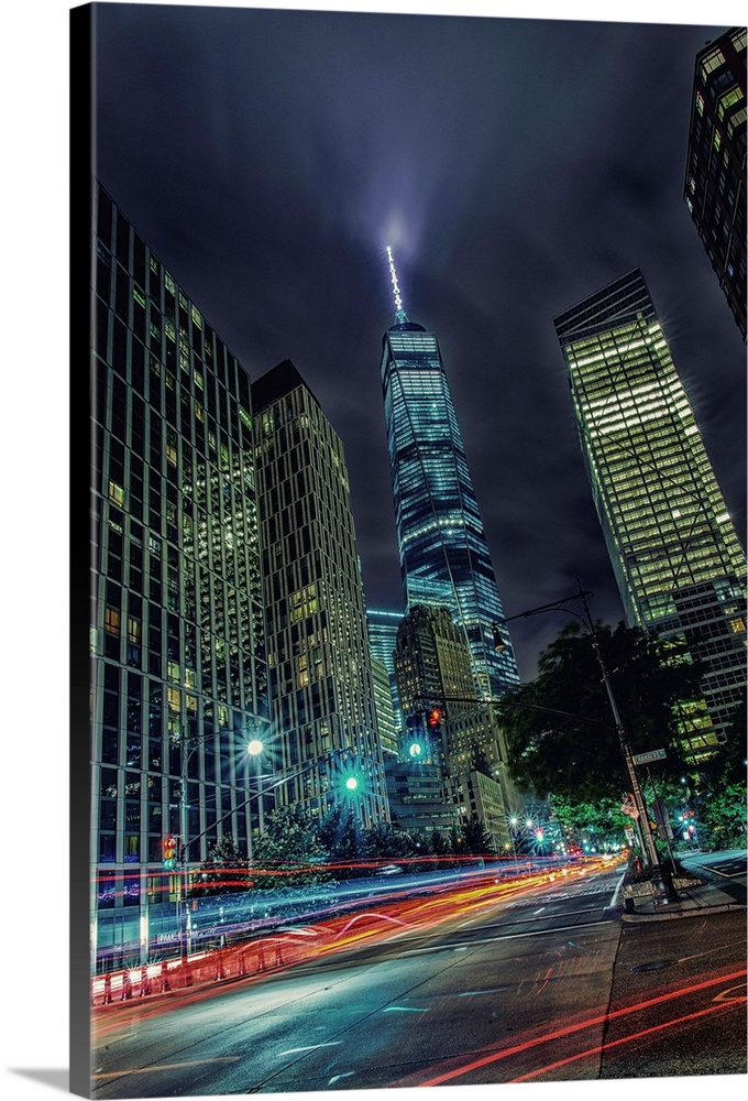 Large Solid-Faced Canvas Print Wall Art Print 24 x 36 entitled Freedom Tower At Night Solid-Faced Canvas Print entitled Freedom Tower At Night.  Multiple sizes available.  Primary colors within this image include Dark Red, Sky Blue, Dark Forest Green, Dark Navy Blue.  Made in the USA.  All products come with a 365 day workmanship guarantee.  Archival-quality UV-resistant inks.  Canvas is handcrafted and made-to-order in the United States using high quality artist-grade canvas.  Canvas depth is 1.25 and includes a finished backing with pre-installed hanging hardware.