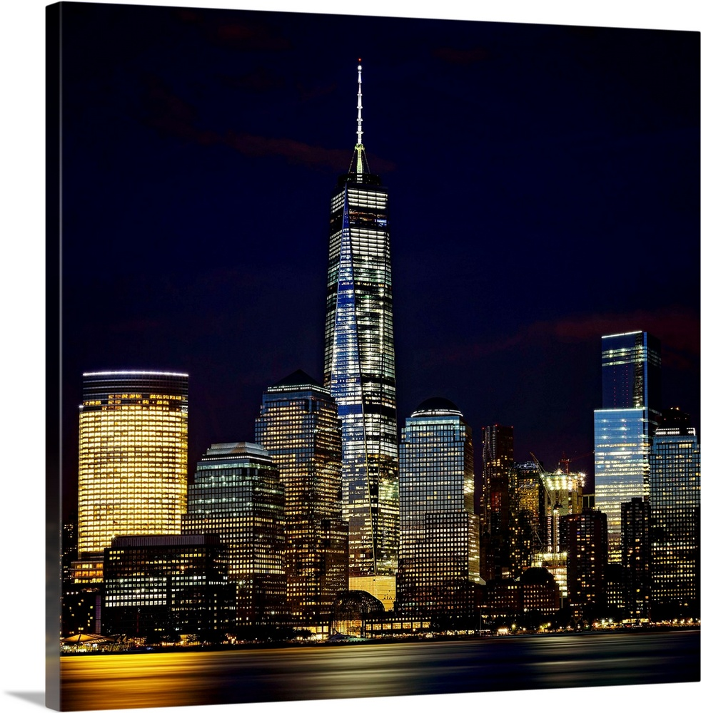 Large Solid-Faced Canvas Print Wall Art Print 24 x 24 entitled Freedom Tower At Night Solid-Faced Canvas Print entitled Freedom Tower At Night.  Multiple sizes available.  Primary colors within this image include Dark Yellow, Peach, Dark Forest Green, Dark Navy Blue.  Made in USA.  All products come with a 365 day workmanship guarantee.  Archival-quality UV-resistant inks.  Canvas depth is 1.25 and includes a finished backing with pre-installed hanging hardware.  Canvas is handcrafted and made-to-order in the United States using high quality artist-grade canvas.