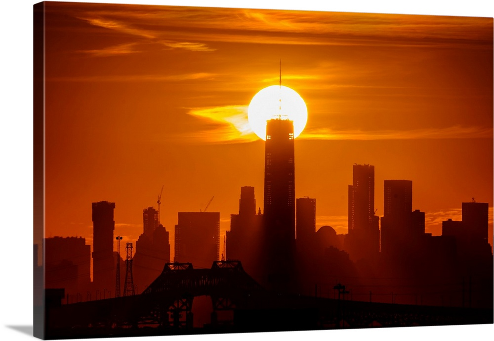 Large Solid-Faced Canvas Print Wall Art Print 36 x 24 entitled Freedom Tower At Sunrise Solid-Faced Canvas Print entitled Freedom Tower At Sunrise.  Multiple sizes available.  Primary colors within this image include Orange, Yellow, Dark Red, Silver.  Made in USA.  All products come with a 365 day workmanship guarantee.  Inks used are latex-based and designed to last.  Featuring a proprietary design, our canvases produce the tightest corners without any bubbles, ripples, or bumps and will not warp or sag over time.  Archival inks prevent fading and preserve as much fine detail as possible with no over-saturation or color shifting.