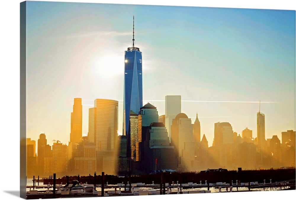 Large Solid-Faced Canvas Print Wall Art Print 36 x 24 entitled Freedom Tower At Sunrise Solid-Faced Canvas Print entitled Freedom Tower At Sunrise.  Multiple sizes available.  Primary colors within this image include Brown, Black, White, Gray Blue.  Made in USA.  Satisfaction guaranteed.  Inks used are latex-based and designed to last.  Archival inks prevent fading and preserve as much fine detail as possible with no over-saturation or color shifting.  Featuring a proprietary design, our canvases produce the tightest corners without any bubbles, ripples, or bumps and will not warp or sag over time.
