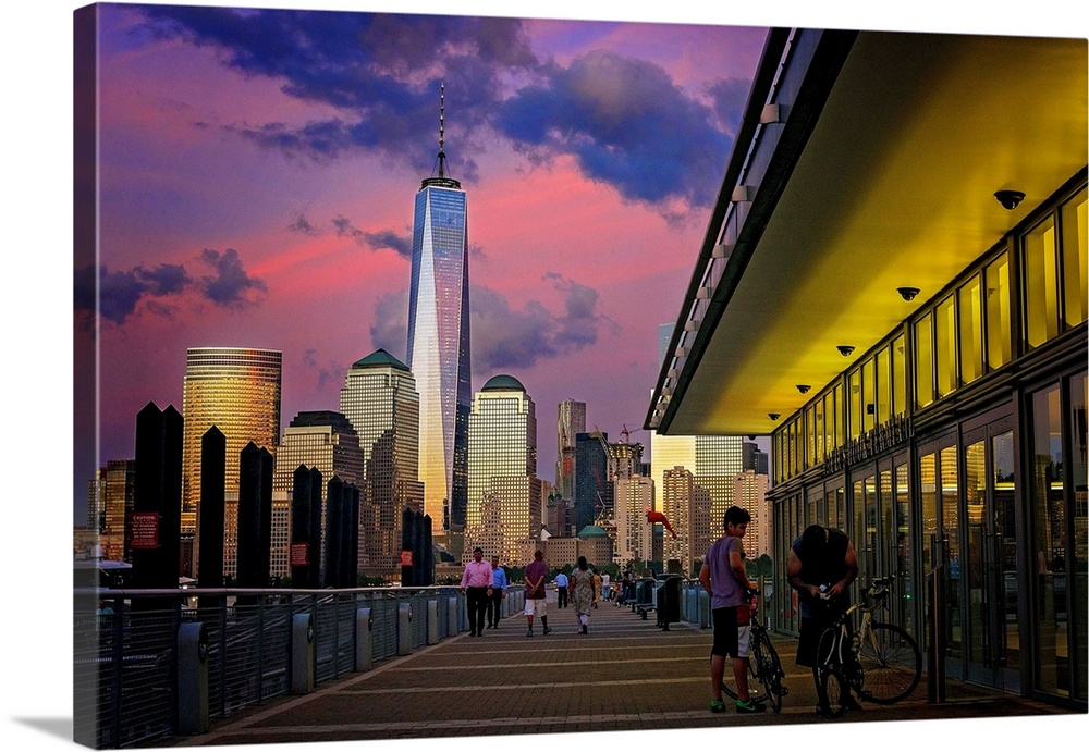 Large Solid-Faced Canvas Print Wall Art Print 36 x 24 entitled Freedom Tower View From New Jersey Solid-Faced Canvas Print entitled Freedom Tower View From New Jersey.  Multiple sizes available.  Primary colors within this image include Dark Yellow, Pink, Peach, Black.  Made in USA.  All products come with a 365 day workmanship guarantee.  Archival-quality UV-resistant inks.  Archival inks prevent fading and preserve as much fine detail as possible with no over-saturation or color shifting.  Canvas is handcrafted and made-to-order in the United States using high quality artist-grade canvas.