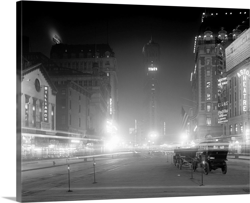 Large Solid-Faced Canvas Print Wall Art Print 30 x 24 entitled Vintage photograph of Times Square at Night, New York City Solid-Faced Canvas Print entitled Vintage photograph of Times Square at Night, New York City.  Multiple sizes available.  Primary colors within this image include Black, Gray, Silver.  Made in the USA.  All products come with a 365 day workmanship guarantee.  Archival-quality UV-resistant inks.  Canvas depth is 1.25 and includes a finished backing with pre-installed hanging hardware.  Canvas is handcrafted and made-to-order in the United States using high quality artist-grade canvas.