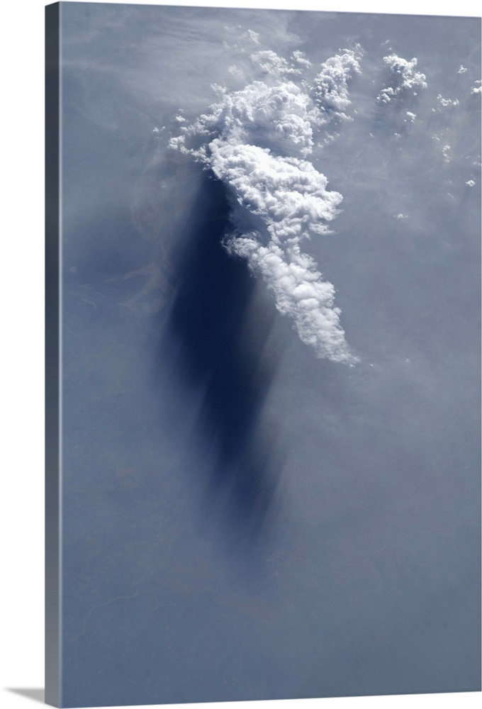 Large Solid-Faced Canvas Print Wall Art Print 20 x 30 entitled Cloud and shadow, late afternoon over the Ganges River delta Solid-Faced Canvas Print entitled Cloud and shadow, late afternoon over the Ganges River delta.  Photograph taken by Commander Chris Hadfield during expedition 35 to the International Space Station.  Multiple sizes available.  Primary colors within this image include Black, White, Gray Blue.  Made in the USA.  Satisfaction guaranteed.  Inks used are latex-based and designed to last.  Featuring a proprietary design, our canvases produce the tightest corners without any bubbles, ripples, or bumps and will not warp or sag over time.  Canvas depth is 1.25 and includes a finished backing with pre-installed hanging hardware.