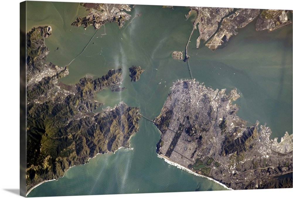 Large Solid-Faced Canvas Print Wall Art Print 30 x 20 entitled The Golden Gate Bridge from space, and if you look closely,... Solid-Faced Canvas Print entitled The Golden Gate Bridge from space, and if you look closely, its shadow.  Photograph taken by Commander Chris Hadfield during expedition 34 to the International Space Station.  Multiple sizes available.  Primary colors within this image include Black, Gray, White.  Made in USA.  Satisfaction guaranteed.  Archival-quality UV-resistant inks.  Canvas depth is 1.25 and includes a finished backing with pre-installed hanging hardware.  Archival inks prevent fading and preserve as much fine detail as possible with no over-saturation or color shifting.