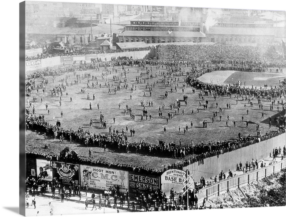 Large Gallery-Wrapped Canvas Wall Art Print 24 x 18 entitled First World Series Game, Huntington Avenue Ball Field, 1903 Gallery-Wrapped Canvas entitled First World Series Game, Huntington Avenue Ball Field, 1903.  This was the scene of the First World Series as it was played at the Huntington Avenue Ball Field in 1903 where Northeastern University now stands. In the series, the Boston Pilgrims were Matched against the Pittsburgh Pirates and Boston won when Bill Dineen struck out the famous Honus Wagner in the seventh game. Notice the crowd clustered around the baseball infield.  Multiple sizes available.  Primary colors within this image include Black, Silver.  Made in USA.  Satisfaction guaranteed.  Inks used are latex-based and designed to last.  Canvas is acid-free and 20 millimeters thick.  Canvas is a 65 polyester, 35 cotton base, with two acrylic latex primer basecoats and a semi-gloss inkjet receptive topcoat.