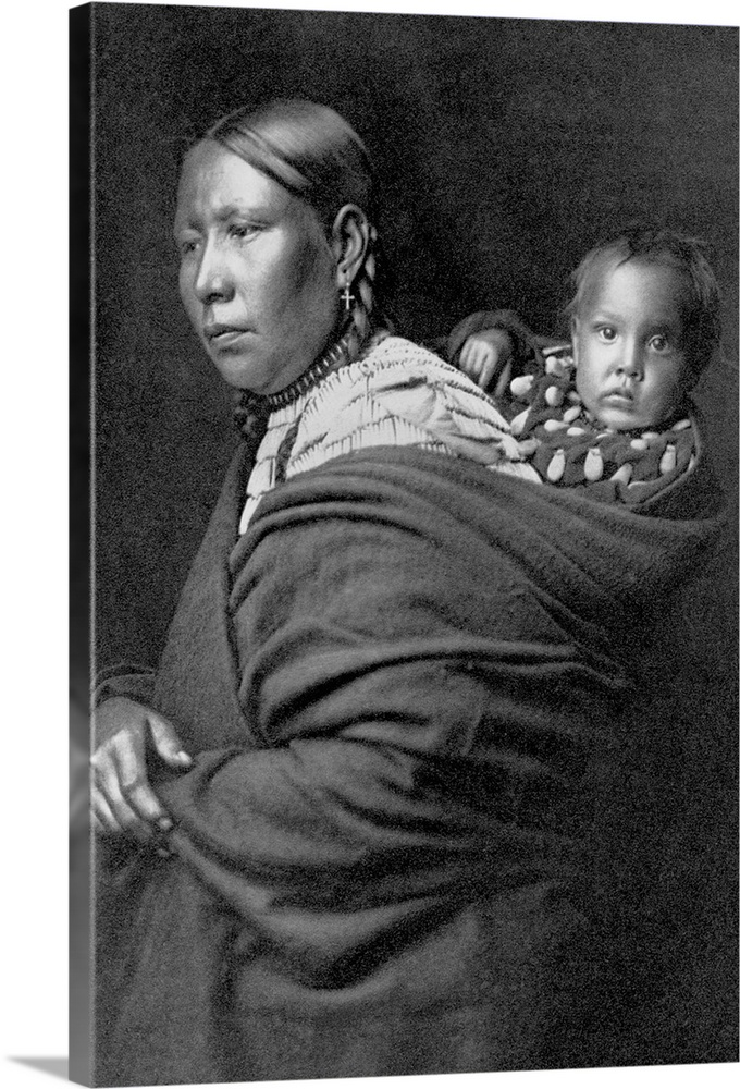 Large Gallery-Wrapped Canvas Wall Art Print 15 x 24 entitled Mother And Child By Edward S. Curtis Gallery-Wrapped Canvas entitled Mother And Child By Edward S. Curtis.  A portrait of a mother and child published in Volume III of The North American Indian 1908 by Edward S. Curtis.  Multiple sizes available.  Primary colors within this image include Dark Gray Silver.  Made in the USA.  All products come with a 365 day workmanship guarantee.  Inks used are latex-based and designed to last.  Museum-quality artist-grade canvas mounted on sturdy wooden stretcher bars 1.5 thick.  Comes ready to hang.  Canvas is a 65 polyester 35 cotton base with two acrylic latex primer basecoats and a semi-gloss inkjet receptive topcoat.