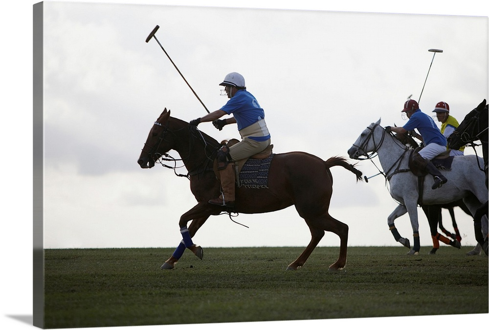 Large Gallery-Wrapped Canvas Wall Art Print 24 x 16 entitled Polo Game Gallery-Wrapped Canvas entitled Polo Game.  Multiple sizes available.  Primary colors within this image include White, Muted Blue, Dark Forest Green.  Made in USA.  Satisfaction guaranteed.  Inks used are latex-based and designed to last.  Canvas is designed to prevent fading.  Canvases have a UVB protection built in to protect against fading and moisture and are designed to last for over 100 years.