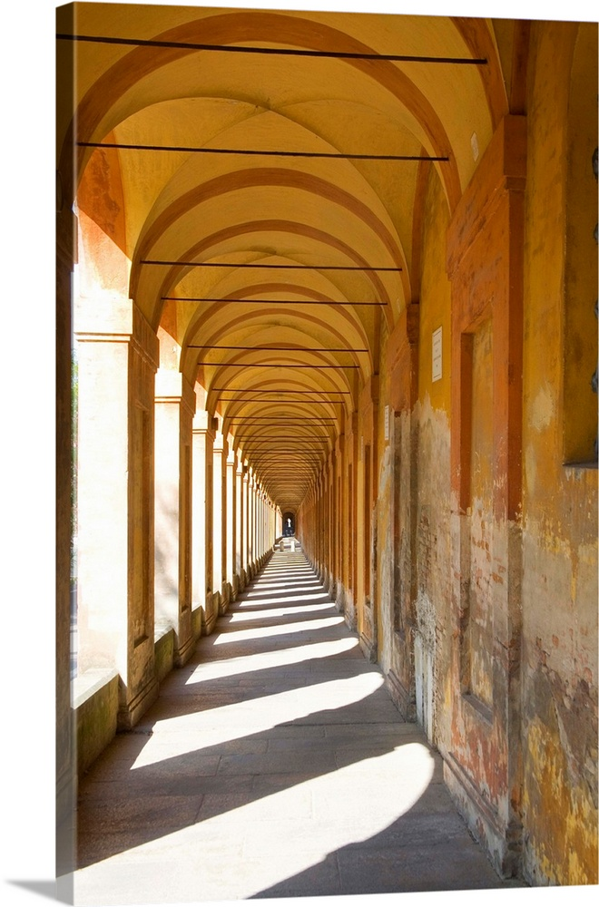 Large Solid-Faced Canvas Print Wall Art Print 20 x 30 entitled Italy, BolognaLong Hallway Pellefrinaggio a San Luca with s... Solid-Faced Canvas Print entitled Italy, BolognaLong Hallway Pellefrinaggio a San Luca with shadows.  Euope,Italy,BolognaLong Hallway Pellefrinaggio a San Luca with shadows.  Multiple sizes available.  Primary colors within this image include Brown, Peach, Black, Gray.  Made in USA.  Satisfaction guaranteed.  Archival-quality UV-resistant inks.  Featuring a proprietary design, our canvases produce the tightest corners without any bubbles, ripples, or bumps and will not warp or sag over time.  Canvas is handcrafted and made-to-order in the United States using high quality artist-grade canvas.