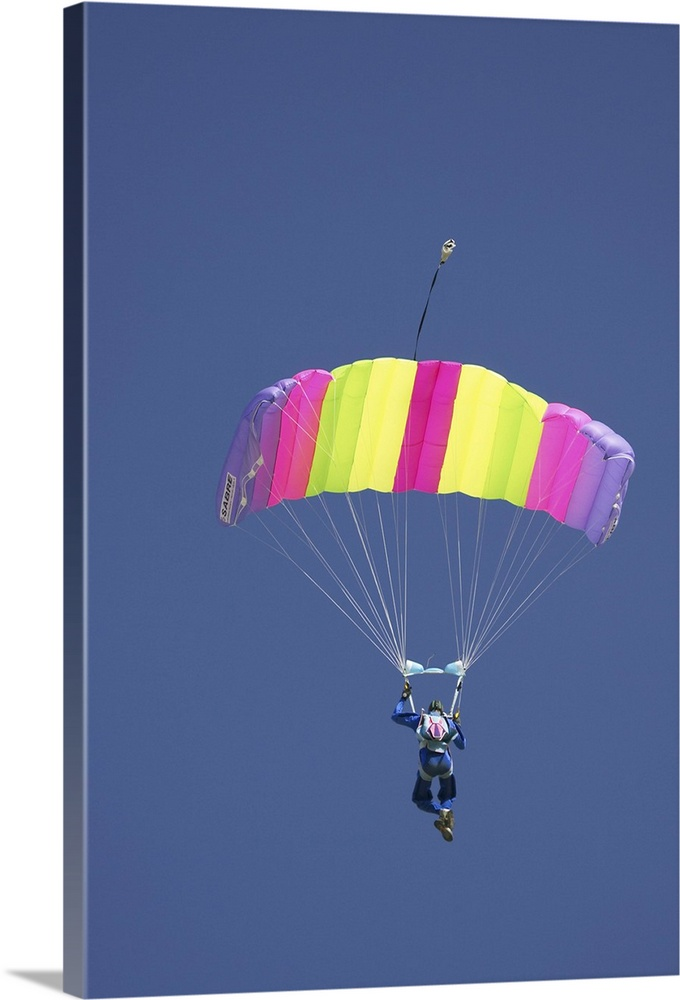 Large Gallery-Wrapped Canvas Wall Art Print 16 x 24 entitled Parachuter, Omarama, North Otago, South Island, New Zealand Gallery-Wrapped Canvas entitled Parachuter Omarama North Otago South Island New Zealand.  Multiple sizes available.  Primary colors within this image include Fuschia Light Yellow Black Muted Blue.  Made in USA.  All products come with a 365 day workmanship guarantee.  Archival-quality UV-resistant inks.  Canvas frames are built with farmed or reclaimed domestic pine or poplar wood.  Museum-quality artist-grade canvas mounted on sturdy wooden stretcher bars 1.5 thick.  Comes ready to hang.
