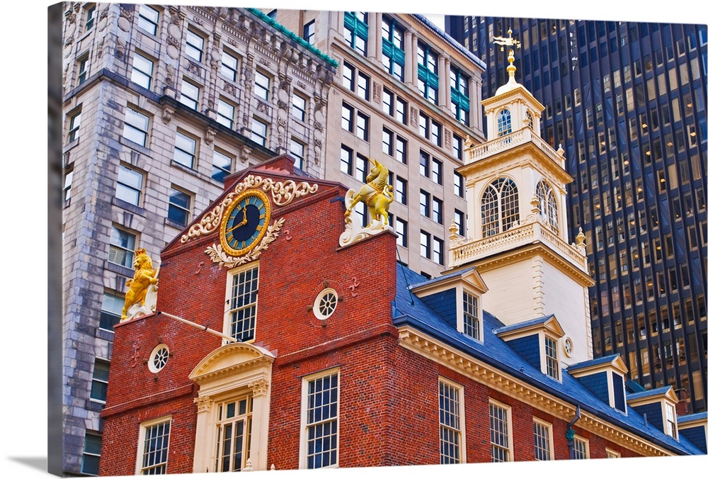 Large Solid-Faced Canvas Print Wall Art Print 36 x 24 entitled The Old State House on the Freedom Trail, Boston, Massachus... Solid-Faced Canvas Print entitled The Old State House on the Freedom Trail, Boston, Massachusetts USA.  Multiple sizes available.  Primary colors within this image include Orange, Dark Red, White, Muted Blue.  Made in the USA.  All products come with a 365 day workmanship guarantee.  Inks used are latex-based and designed to last.  Featuring a proprietary design, our canvases produce the tightest corners without any bubbles, ripples, or bumps and will not warp or sag over time.  Canvas is handcrafted and made-to-order in the United States using high quality artist-grade canvas.