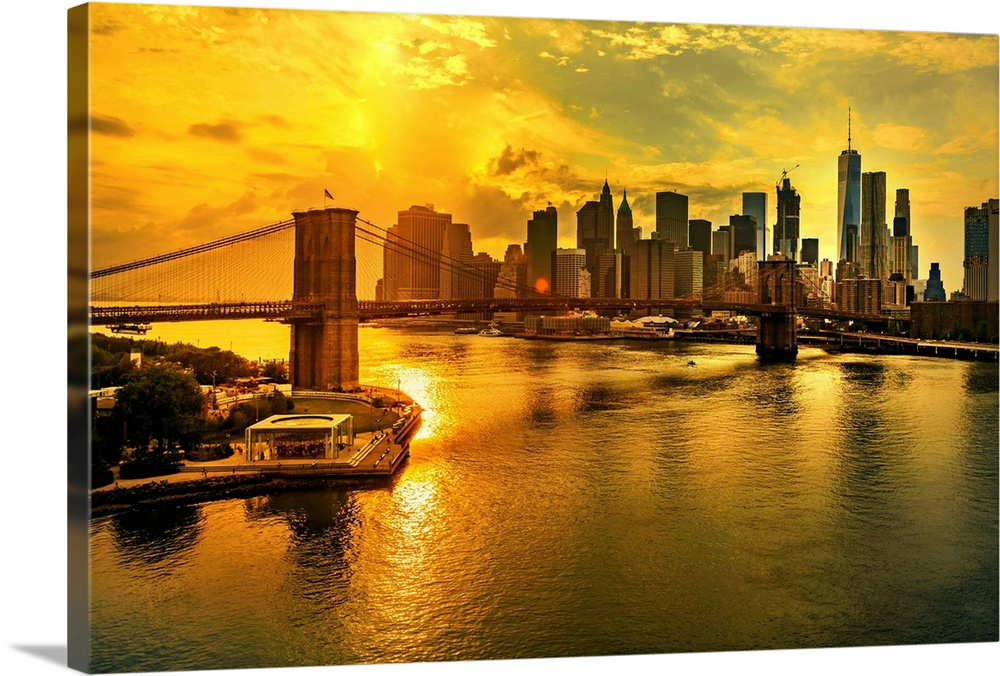 Large Solid-Faced Canvas Print Wall Art Print 36 x 24 entitled Brooklyn Bridge, Downtown And Financial District Skyline At... Solid-Faced Canvas Print entitled Brooklyn Bridge, Downtown And Financial District Skyline At Sunset, New York City.  New York City, Manhattan, East River, Lower Manhattan, Brooklyn Bridge, Downtown and Financial District skyline at sunset, view from the Manhattan Bridge walkway with the Freedom Tower in the background.  Multiple sizes available.  Primary colors within this image include Yellow, Brown, Black.  Made in the USA.  All products come with a 365 day workmanship guarantee.  Inks used are latex-based and designed to last.  Archival inks prevent fading and preserve as much fine detail as possible with no over-saturation or color shifting.  Canvas is handcrafted and made-to-order in the United States using high quality artist-grade canvas.