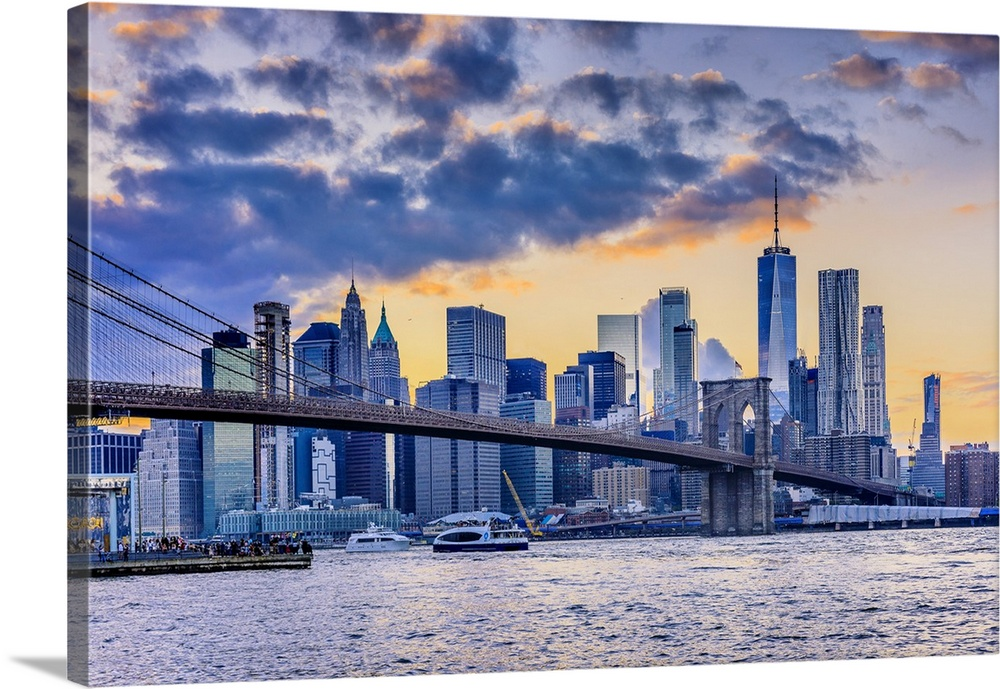 Large Solid-Faced Canvas Print Wall Art Print 36 x 24 entitled Brooklyn, Dumbo, View Of Lower Manhattan Skyline With The O... Solid-Faced Canvas Print entitled Brooklyn, Dumbo, View Of Lower Manhattan Skyline With The One World Trade Center.  USA, New York City, Brooklyn, Dumbo, Brooklyn Bridge Park, View of Lower Manhattan skyline with the One World Trade Center, Freedom Tower.  Multiple sizes available.  Primary colors within this image include Peach, Muted Blue, Gray Blue.  Made in the USA.  Satisfaction guaranteed.  Archival-quality UV-resistant inks.  Canvas is handcrafted and made-to-order in the United States using high quality artist-grade canvas.  Archival inks prevent fading and preserve as much fine detail as possible with no over-saturation or color shifting.
