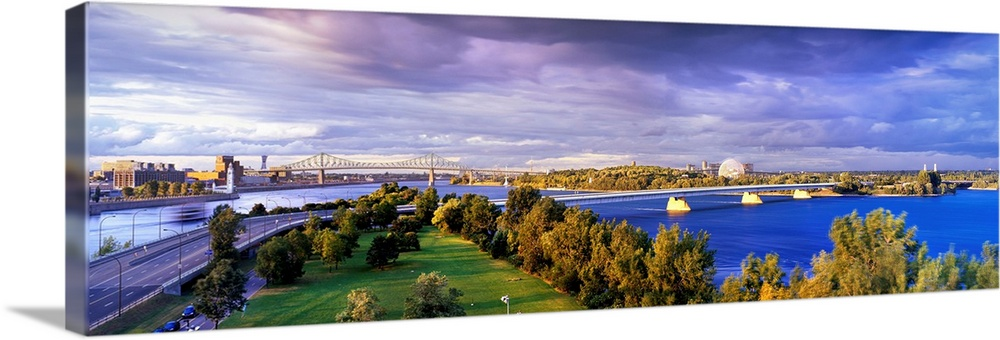 Large Gallery-Wrapped Canvas Wall Art Print 30 x 10 entitled Canada, Quebec, Montreal, View of Jacques Cartier Bridge Gallery-Wrapped Canvas entitled Canada, Quebec, Montreal, View of Jacques Cartier Bridge.  Multiple sizes available.  Primary colors within this image include Brown, Dark Blue, Sky Blue, Muted Blue.  Made in the USA.  All products come with a 365 day workmanship guarantee.  Archival-quality UV-resistant inks.  Canvas is acid-free and 20 millimeters thick.  Museum-quality, artist-grade canvas mounted on sturdy wooden stretcher bars 1.5 thick.  Comes ready to hang.