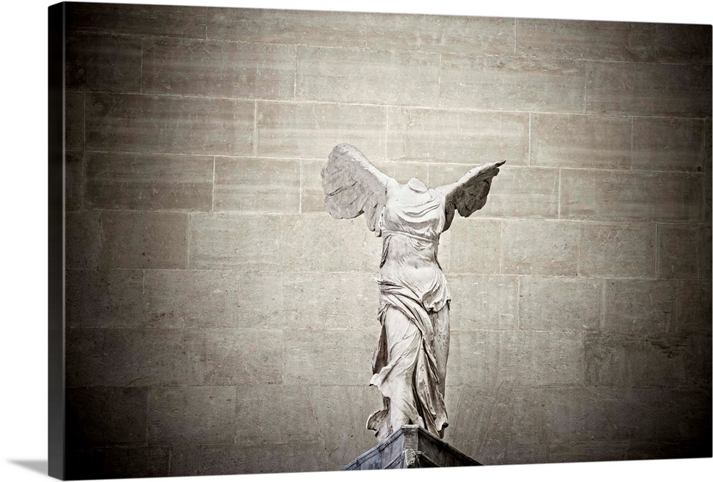 Large Solid-Faced Canvas Print Wall Art Print 30 x 20 entitled France, Paris, The Louvre, The Winged Victory Of Samothrace... Solid-Faced Canvas Print entitled France, Paris, The Louvre, The Winged Victory Of Samothrace Or Nike Of Samothrace.  France, Paris, The Louvre, The Winged Victory of Samothrace, also called Nike of Samothrace.  Multiple sizes available.  Primary colors within this image include Black, Silver.  Made in USA.  Satisfaction guaranteed.  Inks used are latex-based and designed to last.  Archival inks prevent fading and preserve as much fine detail as possible with no over-saturation or color shifting.  Canvas is handcrafted and made-to-order in the United States using high quality artist-grade canvas.