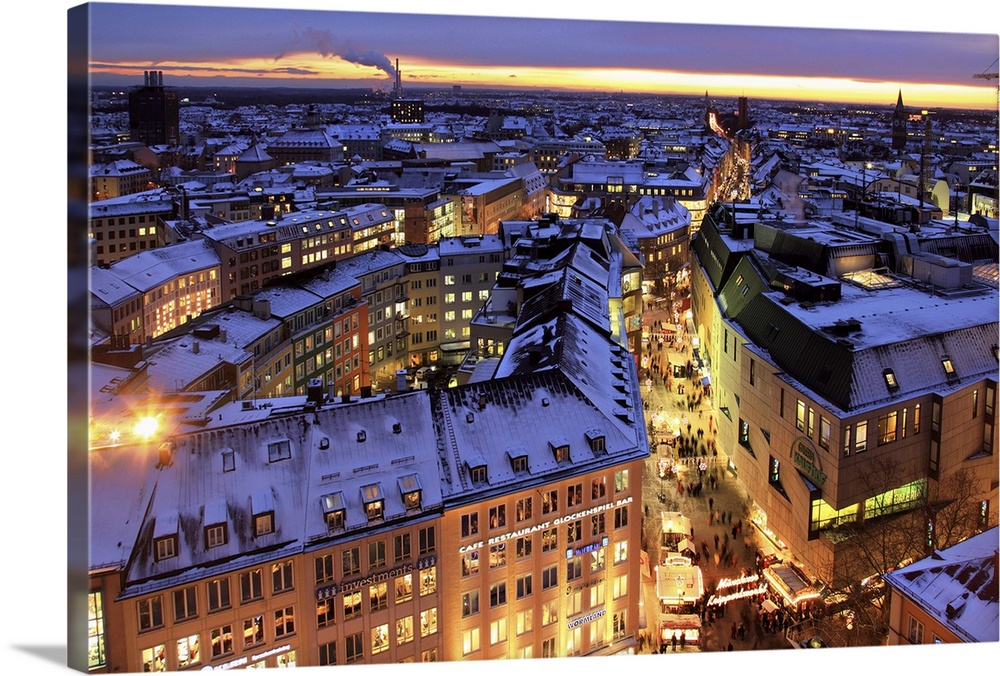Large Solid-Faced Canvas Print Wall Art Print 30 x 20 entitled Germany, Bavaria, Munich, Marienplatz during Christmas time Solid-Faced Canvas Print entitled Germany, Bavaria, Munich, Marienplatz during Christmas time.  Germany, Bavaria, Central Europe, Upper Bavaria, Munich, Marienplatz during Christmas time.  Multiple sizes available.  Primary colors within this image include Peach, Black, Royal Blue.  Made in the USA.  All products come with a 365 day workmanship guarantee.  Archival-quality UV-resistant inks.  Archival inks prevent fading and preserve as much fine detail as possible with no over-saturation or color shifting.  Featuring a proprietary design, our canvases produce the tightest corners without any bubbles, ripples, or bumps and will not warp or sag over time.