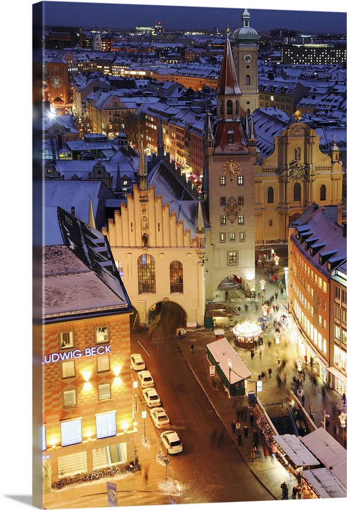 Large Solid-Faced Canvas Print Wall Art Print 20 x 30 entitled Germany, Bavaria, Munich, Marienplatz during Christmas time Solid-Faced Canvas Print entitled Germany, Bavaria, Munich, Marienplatz during Christmas time.  Germany, Bavaria, Central Europe, Upper Bavaria, Munich, Marienplatz during Christmas time.  Multiple sizes available.  Primary colors within this image include Brown, Peach, Muted Blue, Dark Forest Green.  Made in USA.  Satisfaction guaranteed.  Inks used are latex-based and designed to last.  Canvas depth is 1.25 and includes a finished backing with pre-installed hanging hardware.  Archival inks prevent fading and preserve as much fine detail as possible with no over-saturation or color shifting.