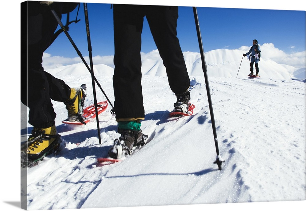 Large Solid-Faced Canvas Print Wall Art Print 30 x 20 entitled Italy, Umbria, Monti Sibillini National Park, Snow shoes tr... Solid-Faced Canvas Print entitled Italy, Umbria, Monti Sibillini National Park, Snow shoes trekking.  Multiple sizes available.  Primary colors within this image include Peach, Black, White, Muted Blue.  Made in the USA.  All products come with a 365 day workmanship guarantee.  Archival-quality UV-resistant inks.  Canvas is handcrafted and made-to-order in the United States using high quality artist-grade canvas.  Archival inks prevent fading and preserve as much fine detail as possible with no over-saturation or color shifting.