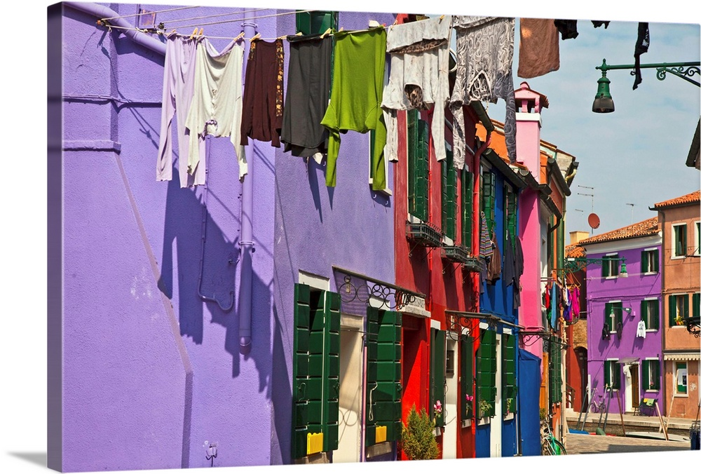 Large Solid-Faced Canvas Print Wall Art Print 30 x 20 entitled Italy, Venice, Washed clothes hanging Solid-Faced Canvas Print entitled Italy, Venice, Washed clothes hanging.  Multiple sizes available.  Primary colors within this image include Orange, Pink, Royal Blue.  Made in the USA.  All products come with a 365 day workmanship guarantee.  Archival-quality UV-resistant inks.  Archival inks prevent fading and preserve as much fine detail as possible with no over-saturation or color shifting.  Canvas is handcrafted and made-to-order in the United States using high quality artist-grade canvas.