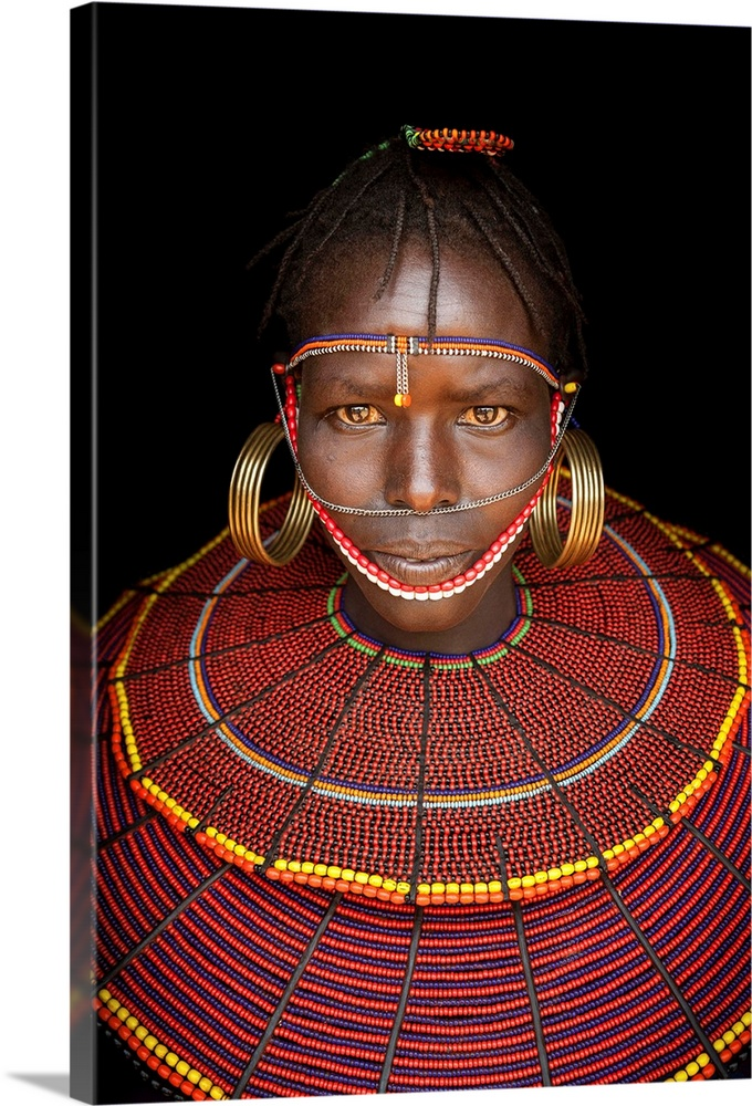 Large Solid-Faced Canvas Print Wall Art Print 20 x 30 entitled Kenya, Central, Pokot girl in traditional clothing Solid-Faced Canvas Print entitled Kenya, Central, Pokot girl in traditional clothing.  Kenya, Central, Pokot girl in traditional clothing.  Multiple sizes available.  Primary colors within this image include Yellow, Dark Red, Brown, Pink.  Made in USA.  All products come with a 365 day workmanship guarantee.  Inks used are latex-based and designed to last.  Canvas is handcrafted and made-to-order in the United States using high quality artist-grade canvas.  Canvas depth is 1.25 and includes a finished backing with pre-installed hanging hardware.