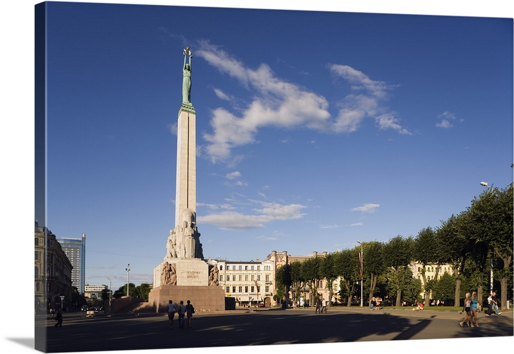 Large Solid-Faced Canvas Print Wall Art Print 36 x 24 entitled Latvia, Riga district, Riga, Baltic States, Freedom Monumen... Solid-Faced Canvas Print entitled Latvia, Riga district, Riga, Baltic States, Freedom Monument aka Liberty Monument.  Multiple sizes available.  Primary colors within this image include Peach, Black, Muted Blue, Light Gray Blue.  Made in the USA.  All products come with a 365 day workmanship guarantee.  Archival-quality UV-resistant inks.  Featuring a proprietary design, our canvases produce the tightest corners without any bubbles, ripples, or bumps and will not warp or sag over time.  Archival inks prevent fading and preserve as much fine detail as possible with no over-saturation or color shifting.