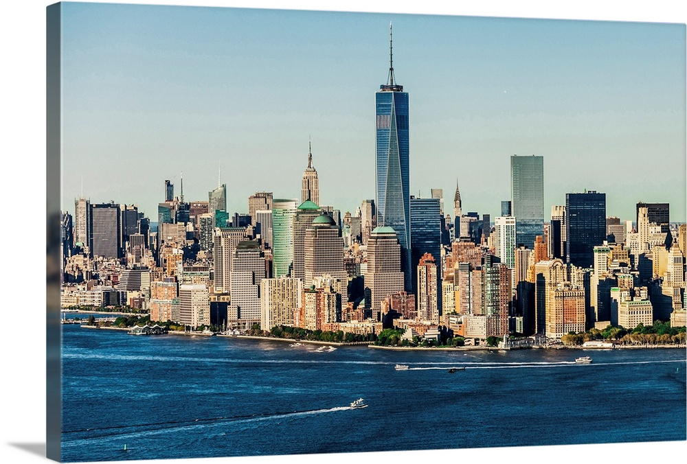 Large Solid-Faced Canvas Print Wall Art Print 36 x 24 entitled Lower Manhattan Solid-Faced Canvas Print entitled Lower Manhattan.  USA, New York City, Manhattan, Lower Manhattan, Aerial view of Manhattan, Freedom tower, Empire State Building, financial district, lower Manhattan.  Multiple sizes available.  Primary colors within this image include Peach, Black, Dark Navy Blue, Light Gray Blue.  Made in USA.  All products come with a 365 day workmanship guarantee.  Archival-quality UV-resistant inks.  Featuring a proprietary design, our canvases produce the tightest corners without any bubbles, ripples, or bumps and will not warp or sag over time.  Canvas depth is 1.25 and includes a finished backing with pre-installed hanging hardware.