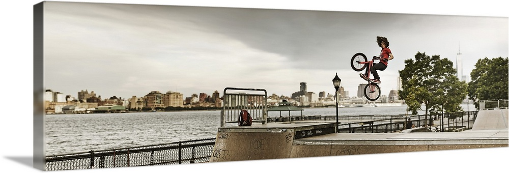 Large Solid-Faced Canvas Print Wall Art Print 60 x 20 entitled New Jersey, Hoboken, BMX biker at Castle Point Skate Park Solid-Faced Canvas Print entitled New Jersey, Hoboken, BMX biker at Castle Point Skate Park.  USA, New Jersey, Hoboken, BMX biker at Castle Point Skate Park with the Freedom Tower in the background.  Multiple sizes available.  Primary colors within this image include Black, Gray, White.  Made in USA.  Satisfaction guaranteed.  Inks used are latex-based and designed to last.  Canvas is handcrafted and made-to-order in the United States using high quality artist-grade canvas.  Canvas depth is 1.25 and includes a finished backing with pre-installed hanging hardware.