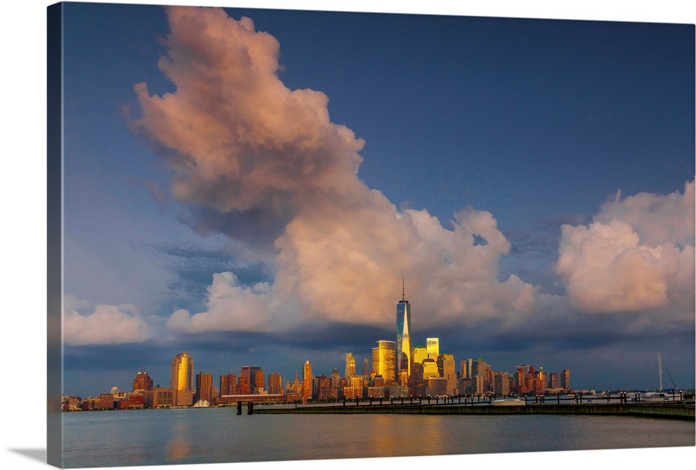 Large Solid-Faced Canvas Print Wall Art Print 36 x 24 entitled New York City, Hudson, Manhattan, One World Trade Center, F... Solid-Faced Canvas Print entitled New York City, Hudson, Manhattan, One World Trade Center, Freedom Tower.  USA, New York City, Hudson, Manhattan, Lower Manhattan, One World Trade Center, Freedom Tower, skyline from New Jersey.  Multiple sizes available.  Primary colors within this image include Orange, Light Yellow, Light Gray, Dark Navy Blue.  Made in the USA.  Satisfaction guaranteed.  Archival-quality UV-resistant inks.  Canvas is handcrafted and made-to-order in the United States using high quality artist-grade canvas.  Canvas depth is 1.25 and includes a finished backing with pre-installed hanging hardware.