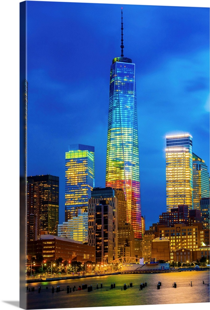 Large Solid-Faced Canvas Print Wall Art Print 24 x 36 entitled New York City, Hudson, Manhattan, One World Trade Center, F... Solid-Faced Canvas Print entitled New York City, Hudson, Manhattan, One World Trade Center, Freedom Tower.  USA, New York City, Hudson, Manhattan, Lower Manhattan, One World Trade Center, Freedom Tower.  Multiple sizes available.  Primary colors within this image include Dark Blue, Light Yellow, Black, Royal Blue.  Made in the USA.  Satisfaction guaranteed.  Inks used are latex-based and designed to last.  Canvas depth is 1.25 and includes a finished backing with pre-installed hanging hardware.  Archival inks prevent fading and preserve as much fine detail as possible with no over-saturation or color shifting.