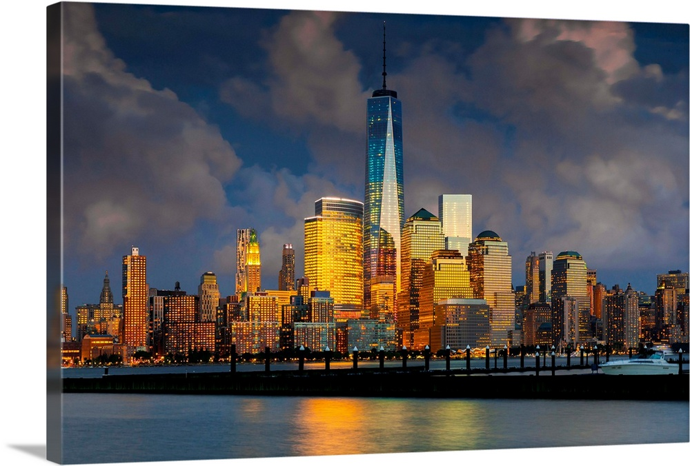 Large Solid-Faced Canvas Print Wall Art Print 36 x 24 entitled New York City, Hudson, Manhattan, One World Trade Center, F... Solid-Faced Canvas Print entitled New York City, Hudson, Manhattan, One World Trade Center, Freedom Tower.  USA, New York City, Hudson, Manhattan, Lower Manhattan, One World Trade Center, Freedom Tower, Skyline from New Jersey.  Multiple sizes available.  Primary colors within this image include Brown, Light Yellow, Black, Gray.  Made in the USA.  Satisfaction guaranteed.  Archival-quality UV-resistant inks.  Canvas depth is 1.25 and includes a finished backing with pre-installed hanging hardware.  Canvas is handcrafted and made-to-order in the United States using high quality artist-grade canvas.