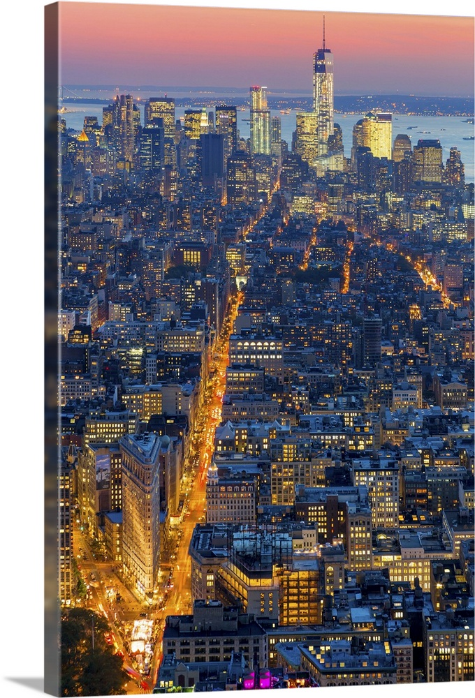 Large Solid-Faced Canvas Print Wall Art Print 24 x 36 entitled New York City, Lower Manhattan cityscape with Freedom Tower Solid-Faced Canvas Print entitled New York City, Lower Manhattan cityscape with Freedom Tower.  USA, New York City, Manhattan, Midtown, Lower Manhattan cityscape with Freedom Tower in the background and Flatiron Building in the foreground at dusk, view from the Empire State Building.  Multiple sizes available.  Primary colors within this image include Brown, Peach, Light Yellow, Black.  Made in USA.  Satisfaction guaranteed.  Archival-quality UV-resistant inks.  Canvas depth is 1.25 and includes a finished backing with pre-installed hanging hardware.  Archival inks prevent fading and preserve as much fine detail as possible with no over-saturation or color shifting.