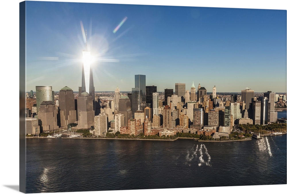 Large Solid-Faced Canvas Print Wall Art Print 36 x 24 entitled New York City, Manhattan, Aerial view of Manhattan, Freedom... Solid-Faced Canvas Print entitled New York City, Manhattan, Aerial view of Manhattan, Freedom Tower, Financial District.  USA, New York City, Manhattan, Lower Manhattan, Aerial view of Manhattan, Freedom Tower, Financial District.  Multiple sizes available.  Primary colors within this image include Brown, Dark Gray, White, Royal Blue.  Made in USA.  All products come with a 365 day workmanship guarantee.  Inks used are latex-based and designed to last.  Canvas depth is 1.25 and includes a finished backing with pre-installed hanging hardware.  Archival inks prevent fading and preserve as much fine detail as possible with no over-saturation or color shifting.