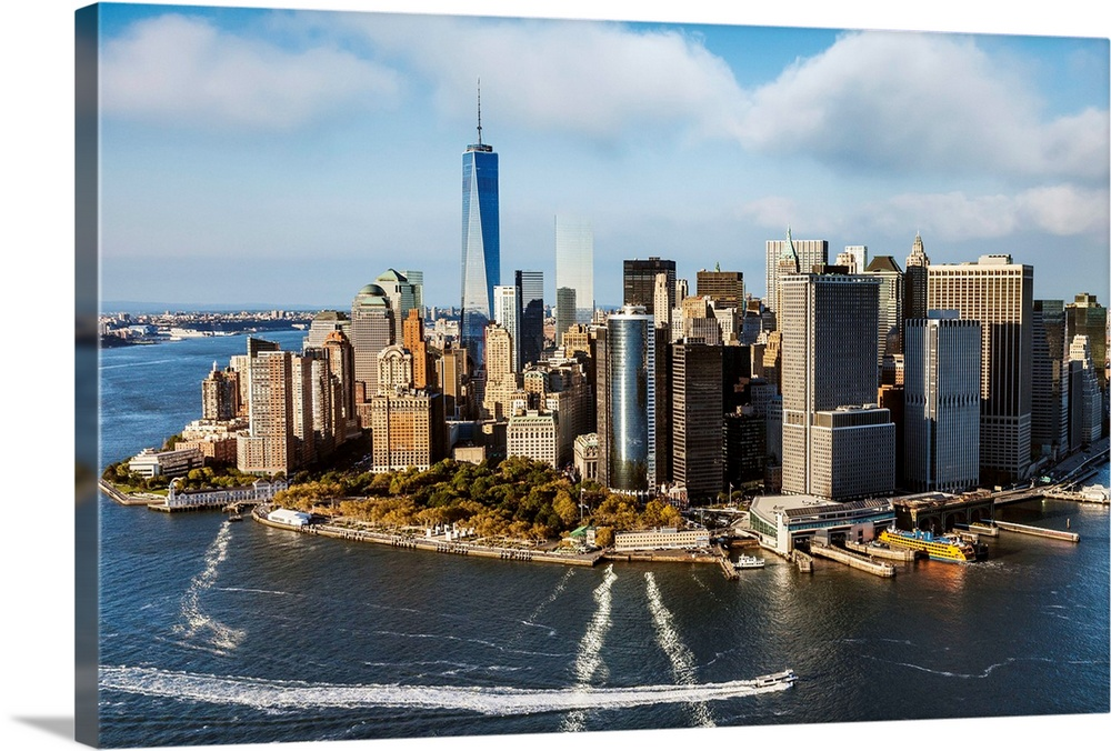 Large Solid-Faced Canvas Print Wall Art Print 36 x 24 entitled New York City, Manhattan, Aerial view of Manhattan, Freedom... Solid-Faced Canvas Print entitled New York City, Manhattan, Aerial view of Manhattan, Freedom Tower, Financial District.  USA, New York City, Manhattan, Lower Manhattan, Aerial view of Manhattan, Freedom Tower, Financial District.  Multiple sizes available.  Primary colors within this image include Brown, Peach, Light Yellow, Black.  Made in the USA.  Satisfaction guaranteed.  Archival-quality UV-resistant inks.  Archival inks prevent fading and preserve as much fine detail as possible with no over-saturation or color shifting.  Canvas is handcrafted and made-to-order in the United States using high quality artist-grade canvas.